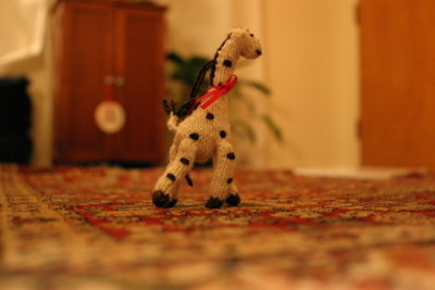 Free range giraffe (crocheted) on a oriental rug savanna